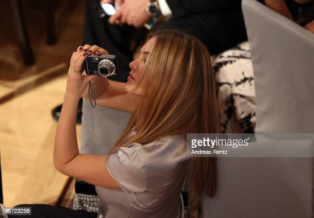 Model Bar Refaeli takes a photograph as she attends the Annual Cinema For Peace Gala during day five of the 60th Berlin International Film Festival...