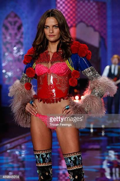 Model Barbara Fialho wears Victoria's Secret Very Sexy Mini Demi Bra and Matching Panty Patent Leather Corset and Bolero Embellished with Swarovski...