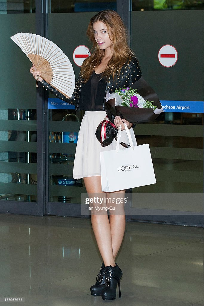 Model Barbara Palvin is seen upon arrival as she holds folding fans at the Incheon International Airport on August 26, 2013 in Incheon, South Korea.