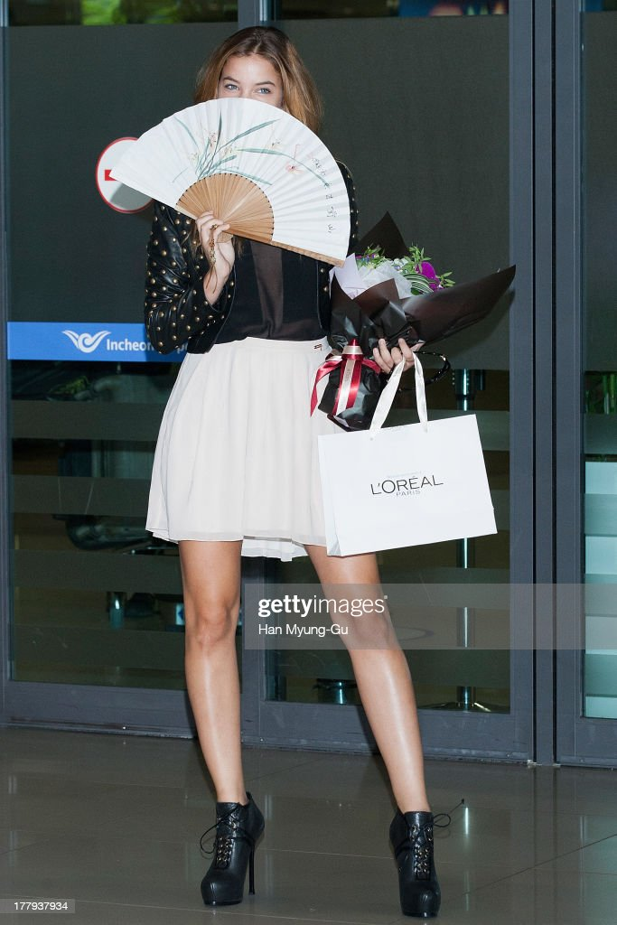 Model <a gi-track='captionPersonalityLinkClicked' href=/galleries/search?phrase=Barbara+Palvin&family=editorial&specificpeople=7190694 ng-click='$event.stopPropagation()'>Barbara Palvin</a> is seen upon arrival as she holds folding fans at the Incheon International Airport on August 26, 2013 in Incheon, South Korea.