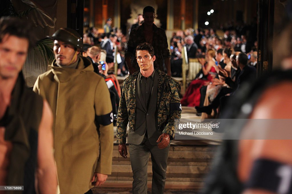 Model Bart Grzybowski walks the runway during the 4th Annual amfAR Inspiration Gala New York at The Plaza Hotel on June 13, 2013 in New York City.