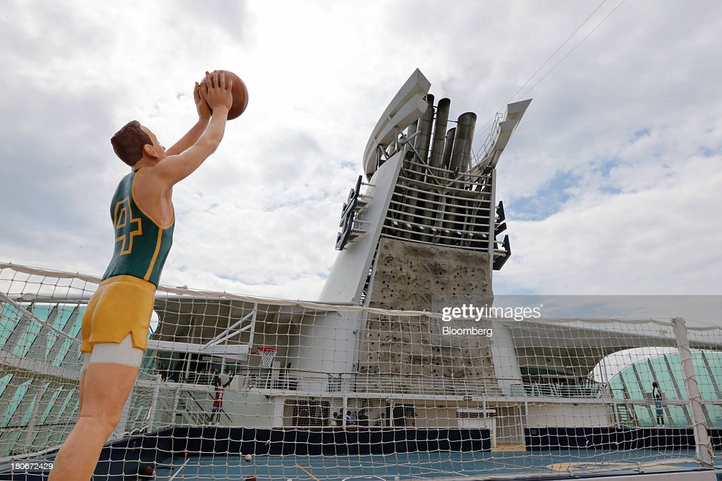 A model basketball figure stands in front of the sports court and rock-climbing wall aboard the Royal Caribbean Cruises Ltd.'s Voyager of the Seas, berthed at the Ohi wharf in Tokyo, Japan, on Saturday, Sept. 14, 2013. Royal Caribbean, the worlds second-largest cruise-line operator, doubled its dividend and will make directors stand for election every year. Photographer: Yuriko Nakao/Bloomberg via Getty Images