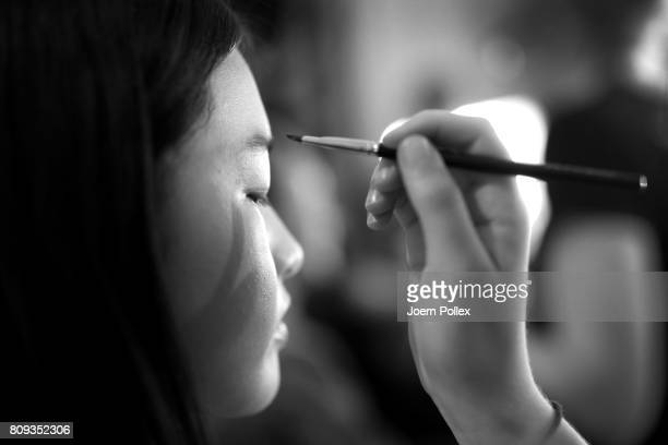 A model beauty detail is seen backstage ahead of the Malaikaraiss show during the MercedesBenz Fashion Week Berlin Spring/Summer 2018 at Kaufhaus...