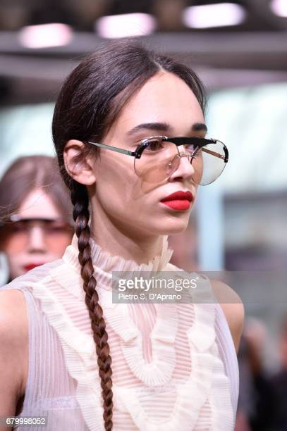 A model beauty detail walks the runway at the Prada Resort Collection 2018 show at Osservatorio Prada on May 7 2017 in Milan Italy