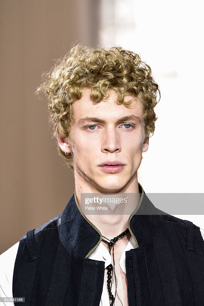 A model, beauty details, walks the runway during the Ann Demeulemeester Menswear Spring/Summer 2017 show as part of Paris Fashion Week on June 24, 2016 in Paris, France.