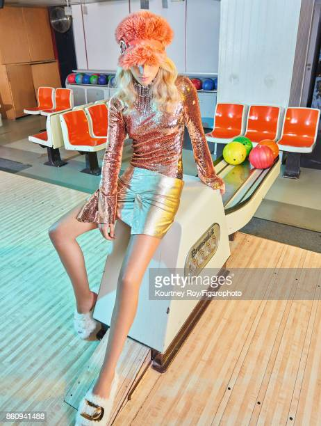 Model poses at a fashion shoot for Madame Figaro on September 7 2017 in Paris France Top skirt hat and necklace slippers PUBLISHED IMAGE CREDIT MUST...