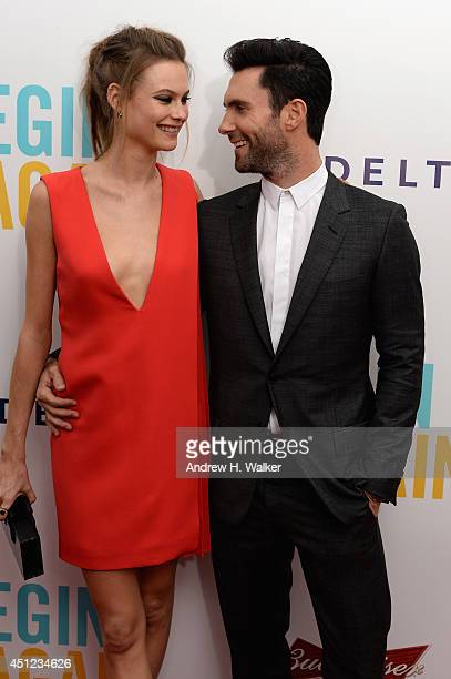 Model Behati Prinsloo and Adam Levine attend the 'Begin Again' premiere at SVA Theater on June 25 2014 in New York City