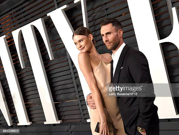 Model Behati Prinsloo and recording artist Adam Levine attend the 2015 Vanity Fair Oscar Party hosted by Graydon Carter at the Wallis Annenberg...
