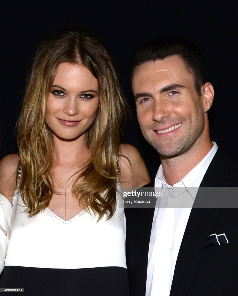 Model <a gi-track='captionPersonalityLinkClicked' href=/galleries/search?phrase=Behati+Prinsloo&family=editorial&specificpeople=4319064 ng-click='$event.stopPropagation()'>Behati Prinsloo</a> and recording artist <a gi-track='captionPersonalityLinkClicked' href=/galleries/search?phrase=Adam+Levine+-+Singer&family=editorial&specificpeople=202962 ng-click='$event.stopPropagation()'>Adam Levine</a> of Maroon 5 attend 'The Night That Changed America: A GRAMMY Salute To The Beatles' at the Los Angeles Convention Center on January 27, 2014 in Los Angeles, California.