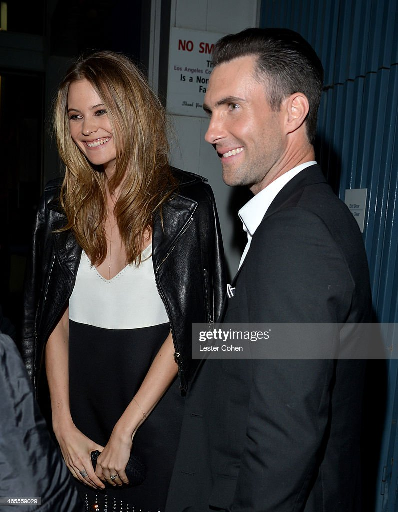 Model <a gi-track='captionPersonalityLinkClicked' href=/galleries/search?phrase=Behati+Prinsloo&family=editorial&specificpeople=4319064 ng-click='$event.stopPropagation()'>Behati Prinsloo</a> (L) and singer-songwriter <a gi-track='captionPersonalityLinkClicked' href=/galleries/search?phrase=Adam+Levine+-+Singer&family=editorial&specificpeople=202962 ng-click='$event.stopPropagation()'>Adam Levine</a> attend 'The Night That Changed America: A GRAMMY Salute To The Beatles' at the Los Angeles Convention Center on January 27, 2014 in Los Angeles, California.