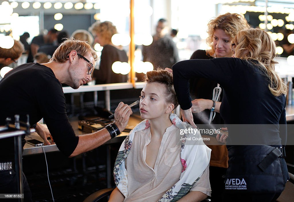 Model being prepped backstage prior to the Creatures Of Comfort Fall 2013 presentation during Mercedes-Benz Fashion Week at Pier 59 on February 6, 2013 in New York City.