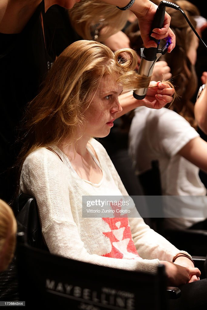 A model being styled backstage ahead of the Laurel Show during the Mercedes-Benz Fashion Week Spring/Summer 2014 at Brandenburg Gate on July 4, 2013 in Berlin, Germany