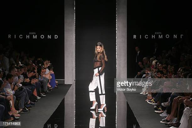 Model Belen Rodriguez walks the runway at the John Richmond show during Milan Menswear Fashion Week Spring Summer 2014 show on June 24 2013 in Milan...