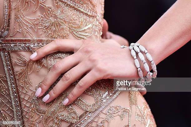 Model Bella Hadid bracelet detail attends the 'Cafe Society' premiere and the Opening Night Gala during the 69th annual Cannes Film Festival at the...