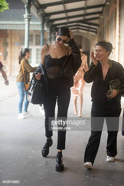Model Bella Hadid exits the Givenchy show during Paris Fashion Week Men's SS17 on June 24 2016 in Paris France Bella carries a Celine purse