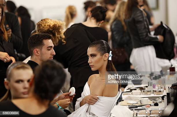 US model Bella Hadid has her makeup applied in a backstage area ahead of the Christian Dior Cruise fashion show at Blenheim Palace in Woodstock near...