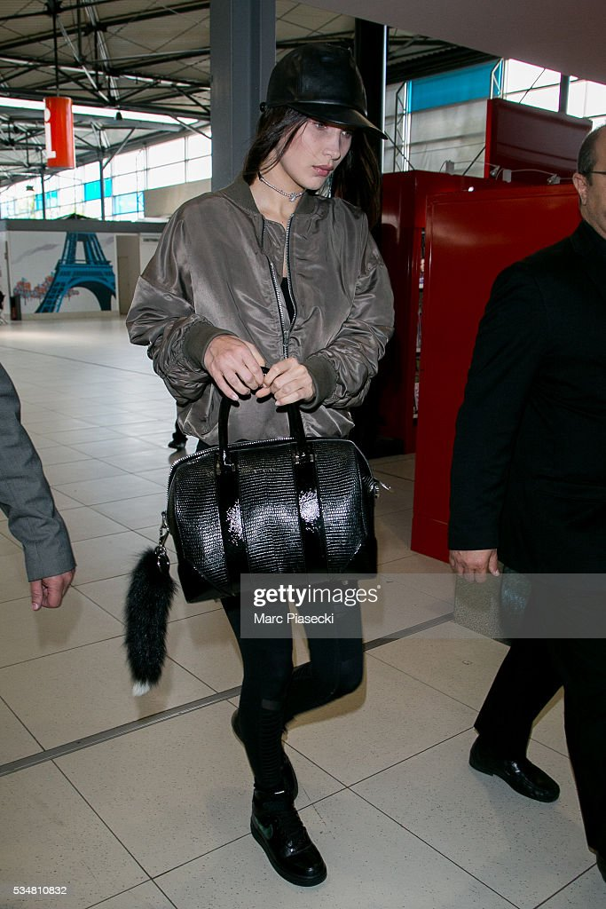 Model <a gi-track='captionPersonalityLinkClicked' href=/galleries/search?phrase=Bella+Hadid&family=editorial&specificpeople=7245032 ng-click='$event.stopPropagation()'>Bella Hadid</a> is seen at Charles-de-Gaulle airport on May 28, 2016 in Paris, France.