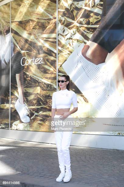 Model Bella Hadid poses as she arrives at 'Nike concept store' Forum des Halles to celebrate 45 years of Nike cortez sneakers on June 10 2017 in...