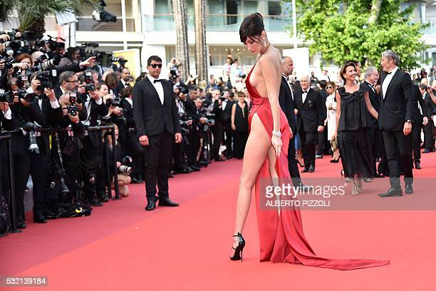 TOPSHOT US model Bella Hadid poses as she arrives on May 18 2016 for the screening of the film 'The Unknown Girl ' at the 69th Cannes Film Festival...