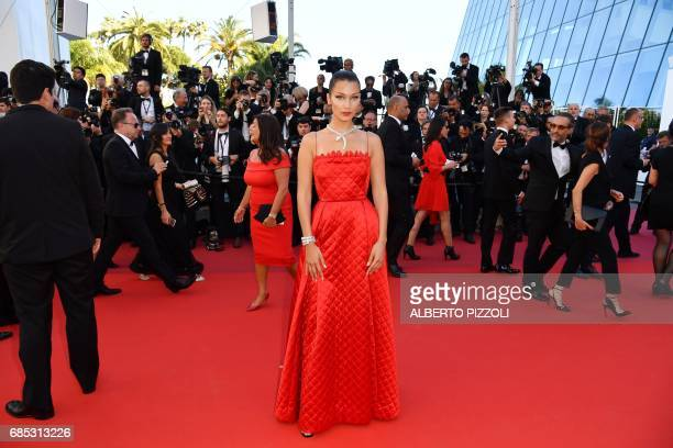 US model Bella Hadid poses as she arrives on May 19 2017 for the screening of the film 'Okja' at the 70th edition of the Cannes Film Festival in...