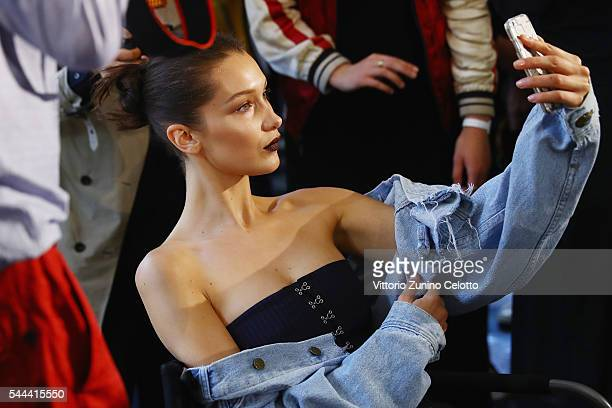 Model Bella Hadid prepares backstage prior to the Atelier Versace Haute Couture Fall/Winter 20162017 show as part of Paris Fashion Week on July 3...