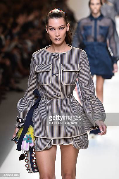 US model Bella Hadid presents a creation for fashion house Fendi during the 2017 Women's Spring / Summer collections shows at Milan Fashion Week on...
