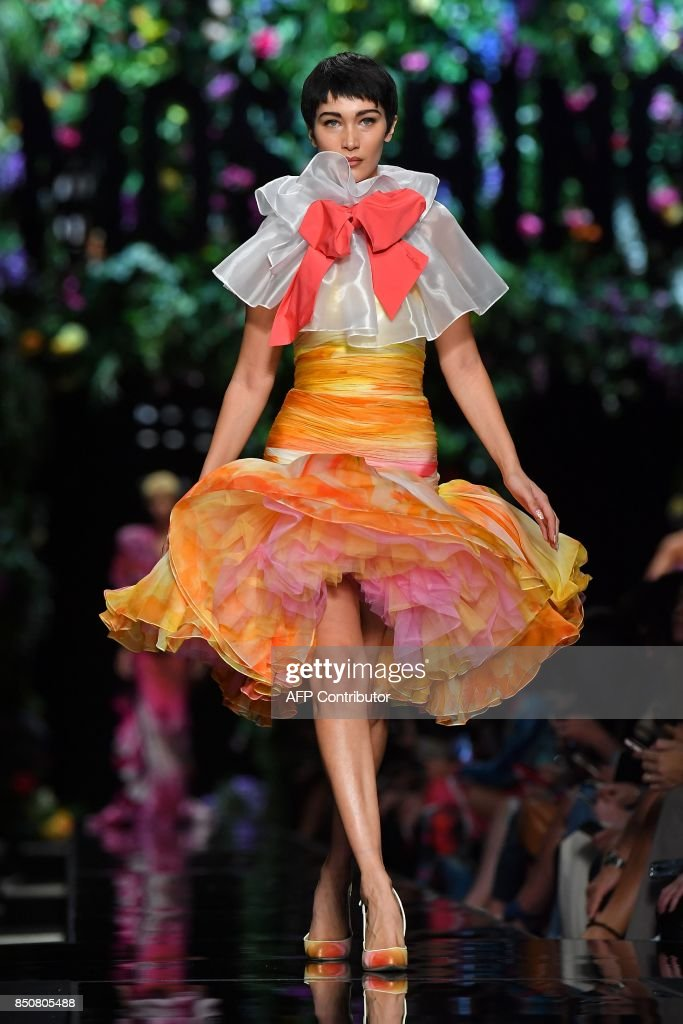 model-bella-hadid-presents-a-creation-for-fashion-house-moschino-the-picture-id850805488