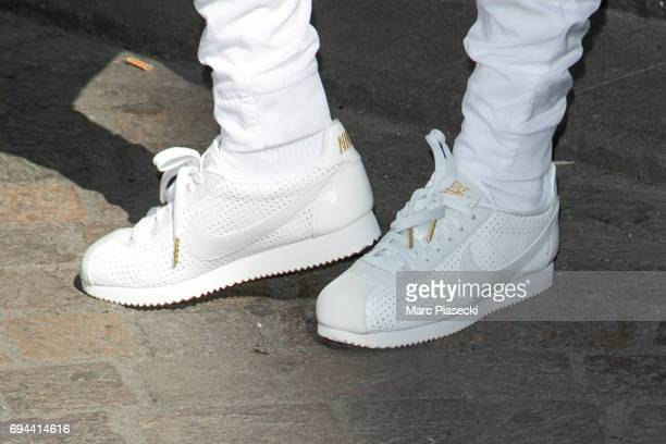 Model Bella Hadid shoe detail poses as she arrives at 'Nike concept store' Forum des Halles to celebrate 45 years of Nike cortez sneakers on June 10...