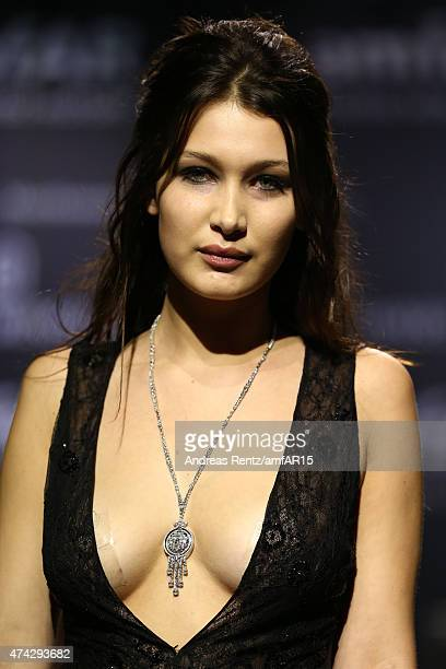 Model Bella Hadid walks during the fashion show runway during amfAR's 22nd Cinema Against AIDS Gala Presented By Bold Films And Harry Winston at...