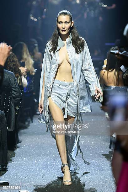 Model Bella Hadid walks the runway during the amfAR's 23rd Cinema Against AIDS Gala at Hotel du CapEdenRoc on May 19 2016 in Cap d'Antibes France