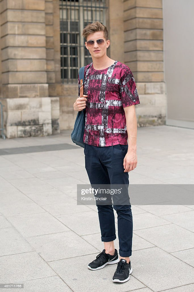 Model Benjamin Benedek wearing nike trainers, Zara trousers, Issey Miyake top and Ray Ban sunglasses on day 3 of Paris Collections: Men on JUNE 27, 2014 in Paris, France.