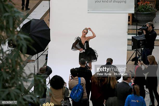 Model Bethan Showerby wears the world's most hitech dress made from graphene at its unveiling at the intu Trafford Centre in Manchester