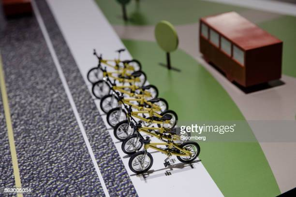 Model bicycles sit on a display on the Ofo Inc hire bicycle exhibition stand at the Autonomy urban mobility summit in Paris France on Thursday Oct 19...
