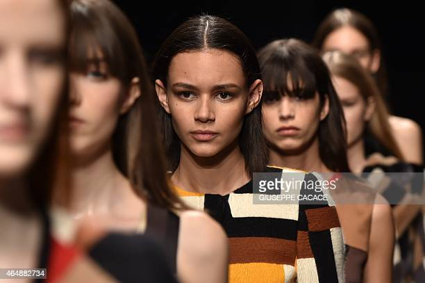 Model Binx Walton presents a creation for fashion house Salvatore Ferragamo at the women Fall / Winter 2015/16 Milan's Fashion Week on March 1 2015...