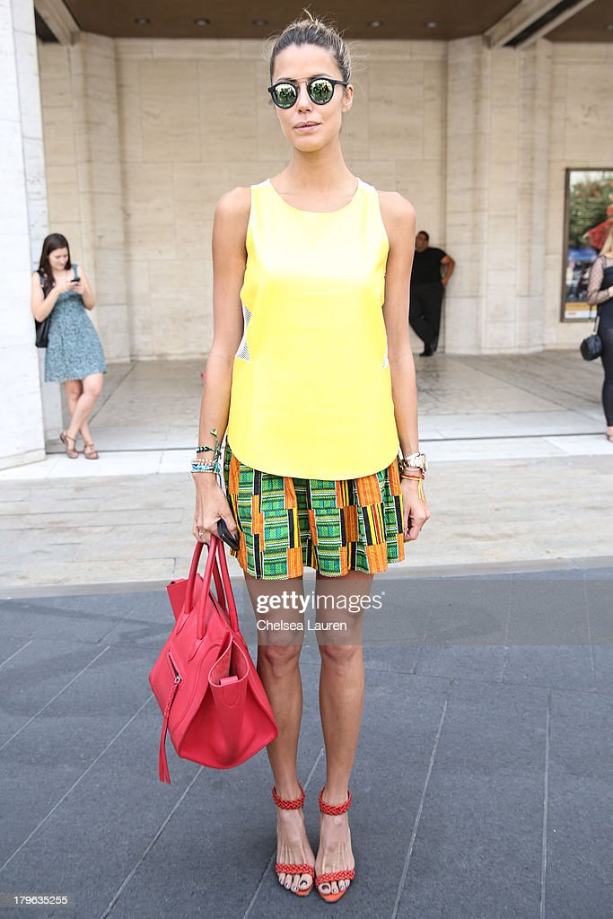Model / blogger Martha Graeff is seen wearing a Hello Parry top, American Apparel skirt, Alexandre Birman shoes, Celine purse, Hipanema bracelets and ASOS sunglasses on the Streets of Manhattan on September 5, 2013 in New York City.