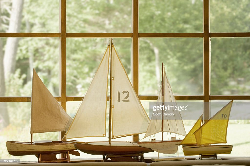 Model boats beside a window : Stockfoto