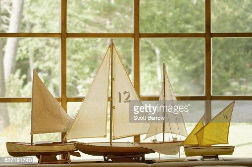 Model boats beside a window : Stock Photo