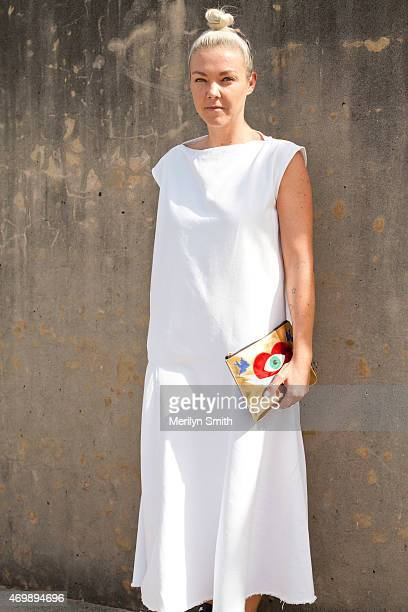 Model Booker Nadine Andrews wears a Basic dress and Poppy Lissiman bag at MercedesBenz Fashion Week Australia 2015 at Carriageworks on April 16 2015...