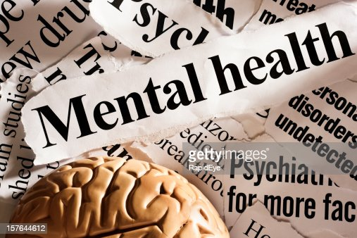 Model brain with headlines on mental health