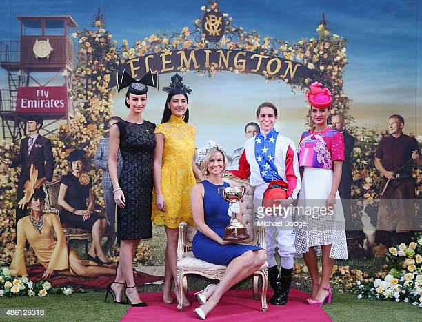 Model Bree Laughlin poses with the Melbourne Cup alongside Alex Hecker 2015 Miss World Australia Runnerup Rebecca Stoneman Ð former Myer Fashions on...