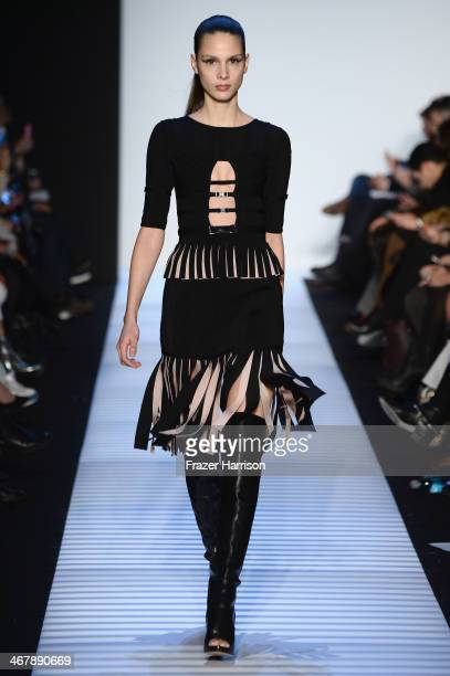 Model Brenda Kranz walks the runway at the Herve Leger By Max Azria fashion show during MercedesBenz Fashion Week Fall 2014 at The Theatre at Lincoln...