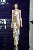 Model Brenda Kranz walks the runway at the Reem Acra fashion show during MercedesBenz Fashion Week Fall 2014 at The Salon at Lincoln Center on...
