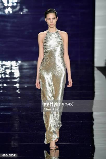 Model Brenda Kranz walks the runway at the Reem Acra fashion show during MercedesBenz Fashion Week Fall 2014 at The Salon at Lincoln Center on...
