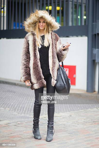 Model Bridget Malcolm exits the Issa show in a vintage coat Helmut Lang top and Acne leather leggings and boots in during London Fashion Week...