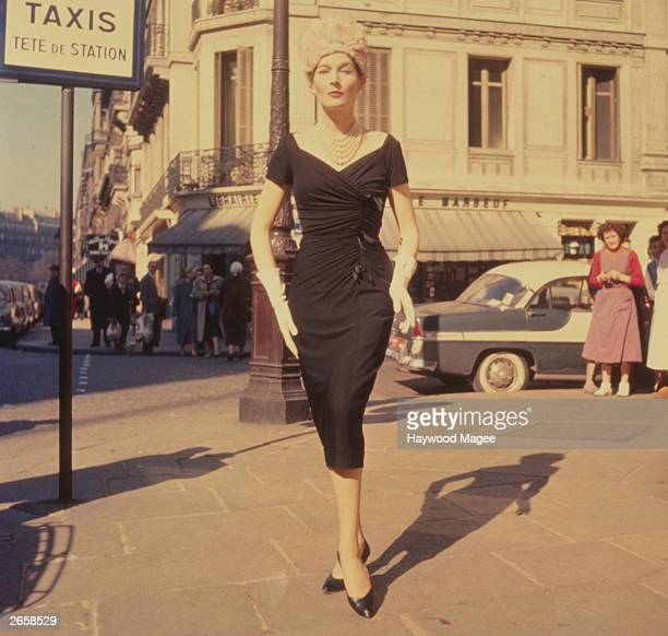 Model Bronwen Pugh wearing a black dress standing in front of a taxi rank sign in Paris Original Publication Picture Post 8877 Bronwen Takes Paris By...