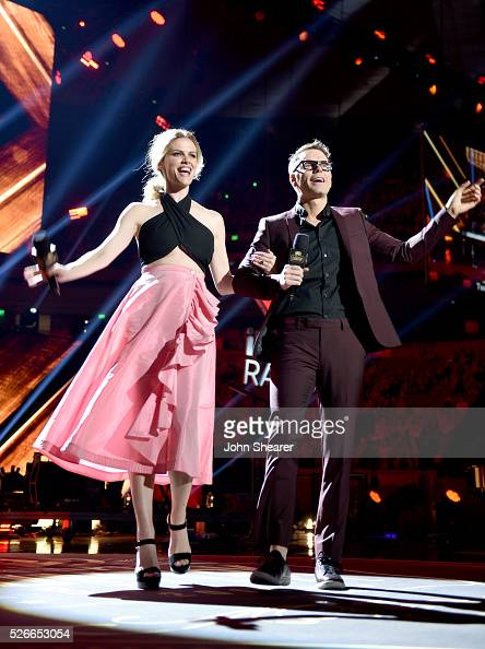Model Brooklyn Decker and Radio personality Bobby Bones perform onstage during the 2016 iHeartCountry Festival at The Frank Erwin Center on April 30...