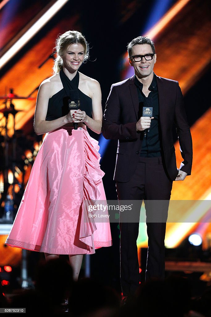 Model Brooklyn Decker and radio personality Bobby Bones speak onstage during the 2016 iHeartCountry Festival at The Frank Erwin Center on April 30, 2016 in Austin, Texas.
