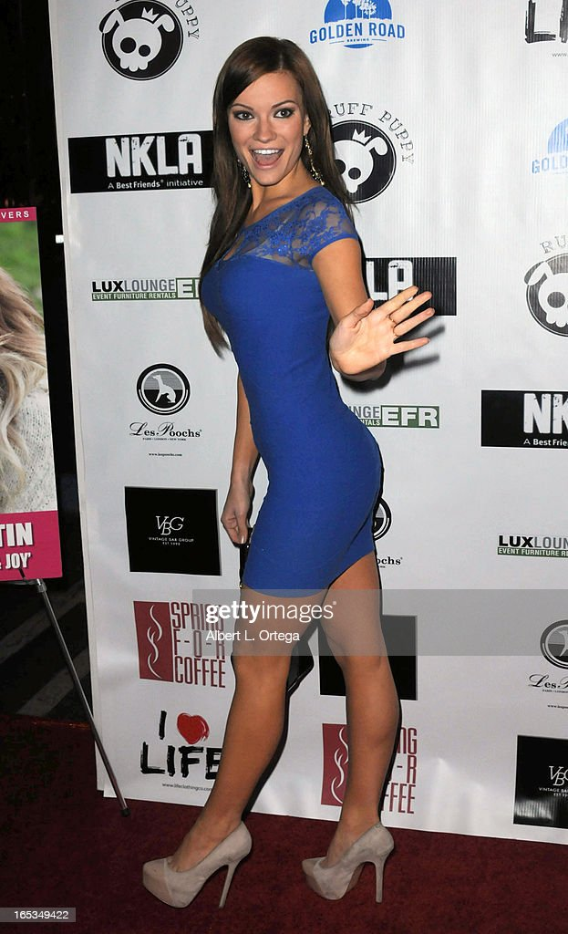 Model Caitlin O'Connor arrives for the No Kill LA Charity Event held at Fred Segal on April 2, 2013 in West Hollywood, California.