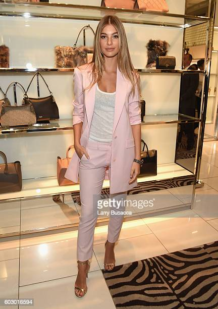 Model Cami Morrone attends the Michael Kors Access Smartwatch launch party at Michael Kors on September 11 2016 in New York City