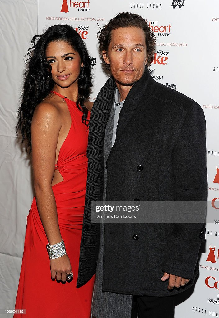 Model <a gi-track='captionPersonalityLinkClicked' href=/galleries/search?phrase=Camila+Alves&family=editorial&specificpeople=4501431 ng-click='$event.stopPropagation()'>Camila Alves</a> (L) and actor <a gi-track='captionPersonalityLinkClicked' href=/galleries/search?phrase=Matthew+McConaughey&family=editorial&specificpeople=201663 ng-click='$event.stopPropagation()'>Matthew McConaughey</a> attend the Heart Truth's Red Dress Collection 2011 during Mecerdes-Benz fashion week at The Theatre at Lincoln Center on February 9, 2011 in New York City.